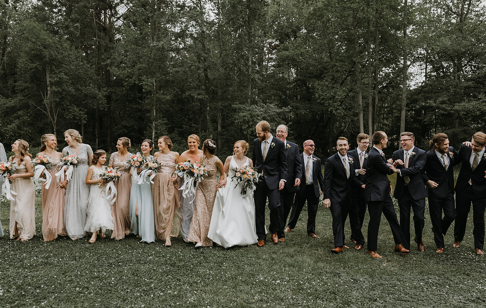 full wedding party walking