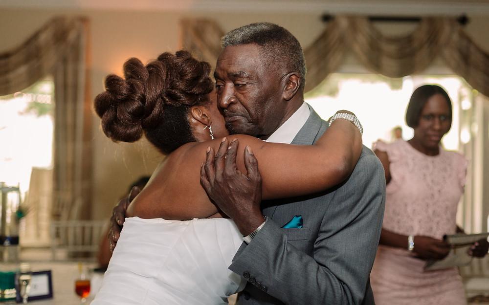 Hugging grandpa at wedding