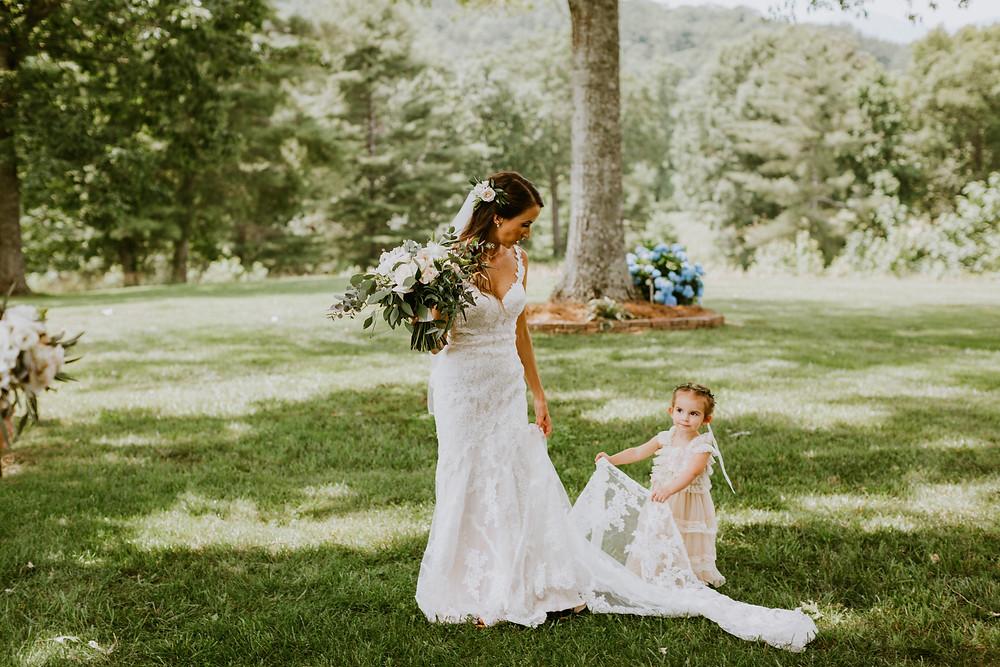 flower girl helps bride