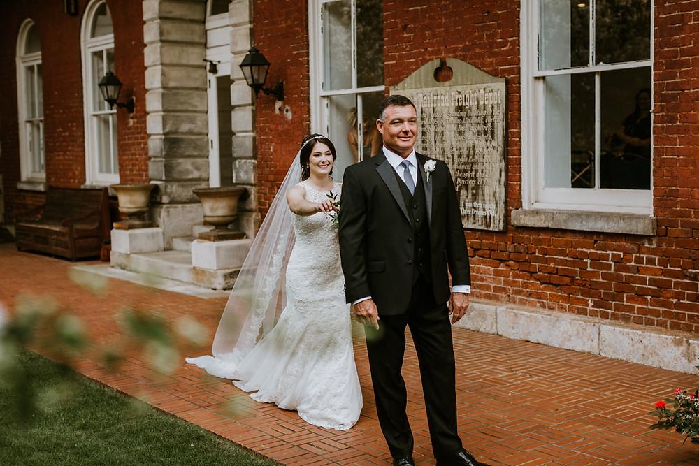 bride taps father on shoulder