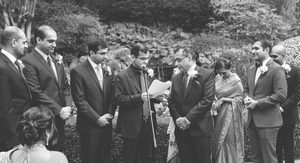 Father and brother giving away bride