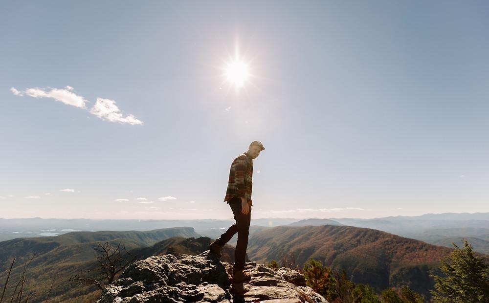 Sun flare on top a mountain