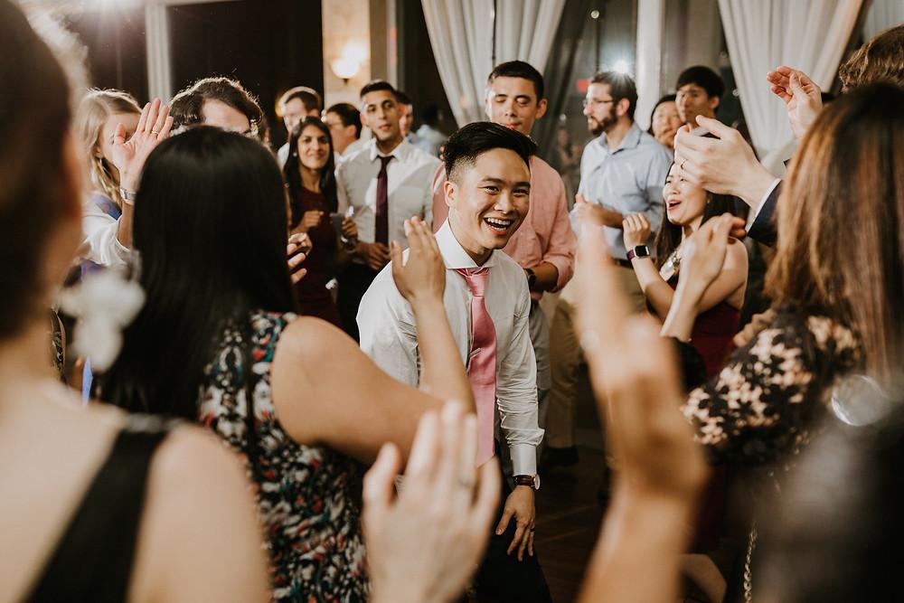 groom candid dancing