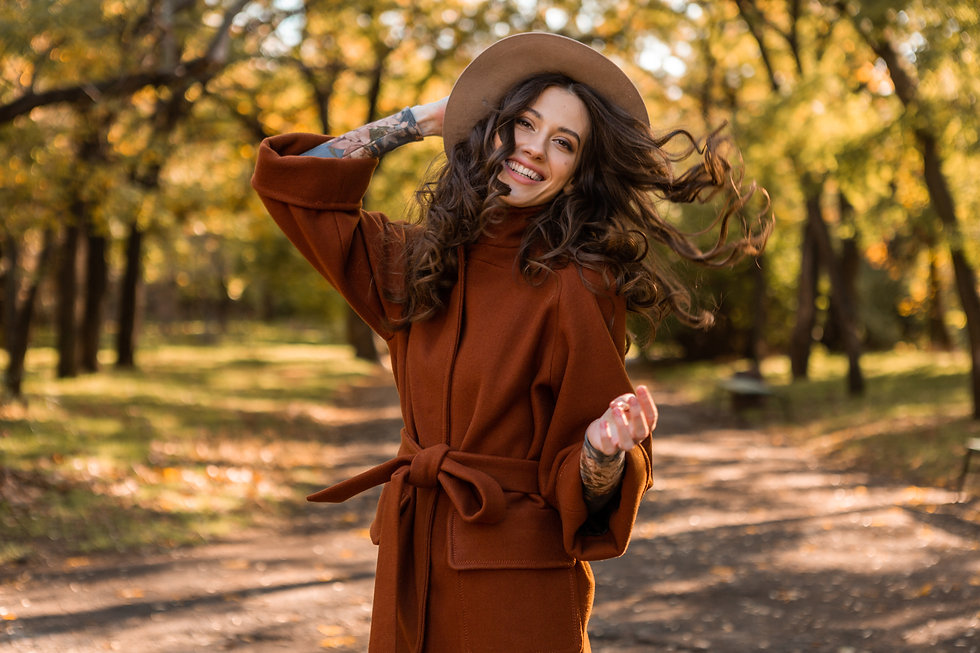 attractive-stylish-smiling-skinny-woman-with-curly-hair-walking-park-dressed-warm-brown-co