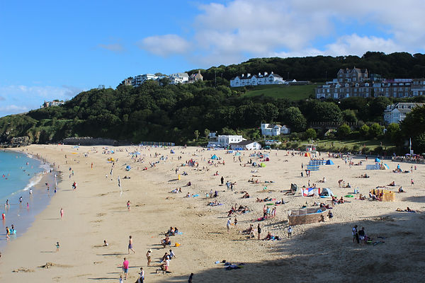 Porthminster beach, Porthminster, beach cafe, family friendly, calm seas, paddleboarding, putting green, lifeguard, golden sands, toilets, refreshments, St Ives railway, beach huts, turquoise sea, blue flag beach, paddling, swimming