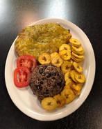 Breaded Steak with chips plaintain and mango-pineapple sauce  Bistec Empanizado con chicharritas y salsa de mango y piña