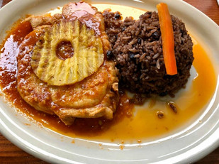Bistec de Puerco Trópical ( Pork steak with pineapple in a sweet & sour sauce) served with Moros Cristianos