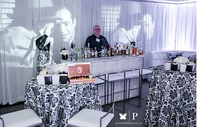A Black and White Decorated Room for a Wedding. Includes a Bar and high tops with linens