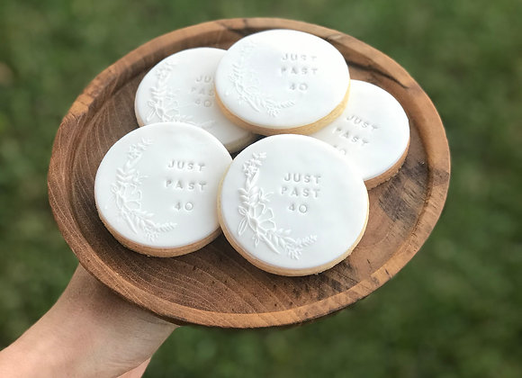 White Cookies with floral stamp and a custom message