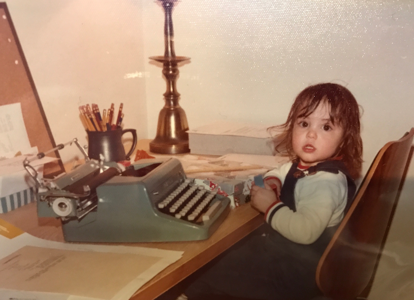 Me, age 2, at a typewriter