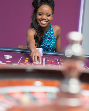 Woman playing roulette at a casino.jpg