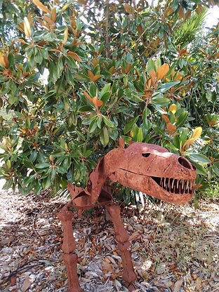 Tiny T-Rex hiding in our Magnolia Tree in our Cretaceous Garden.