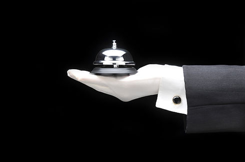 Butlers or concierge holding a service b