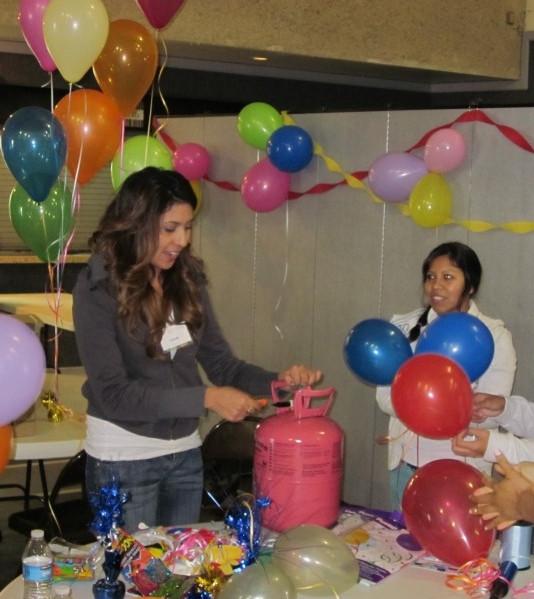 lizette blowing up balloons.jpg