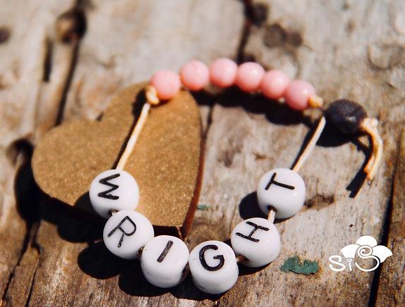 baby girl's birth identification beads
