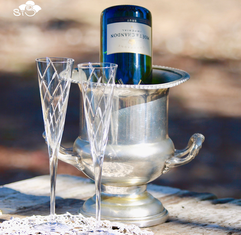 crystal champaign flutes and a silver bucket with an empty Moet bottle - cheers!