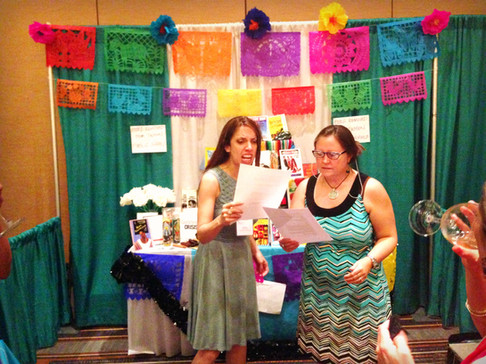 Kimberley Ramirez and Roxanne Schroeder-Arce read at the performance altar