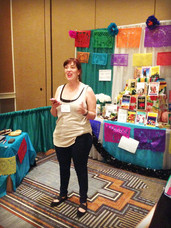 Coya Paz reads at the performance altar