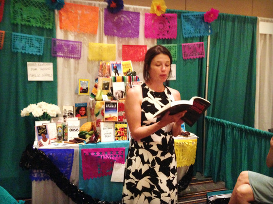 Patricia Ybarra reads at the performance altar