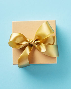 gift-box-with-golden-ribbon-on-bright-ba