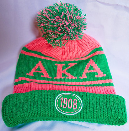 Winter hat with pink and green pom pom