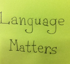 """A green post-it with """"language matters' written on it"""