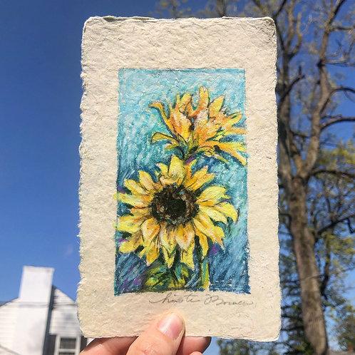 Turquoise ground sunflowers