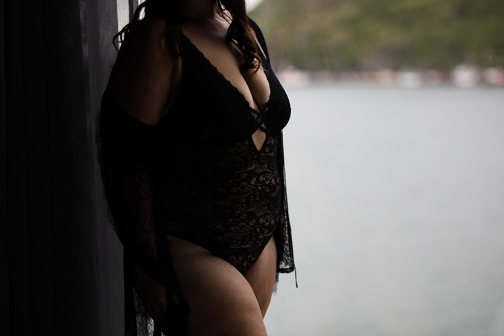 a cropped photo of heather wearing black lace lingerie