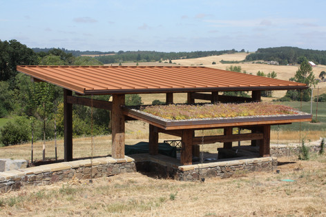 Outdoor shelter with living roof. Design by Nathan Good Architects