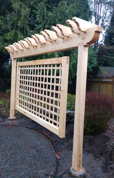 Woven lattice hanging panel with timber framed support.