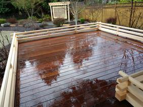 Yoga deck rail with trellis beyond. Design by Kettle River Timberworks, Ltd.