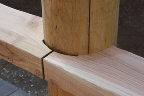 Post/deck rail detail.  Port Orford log column, W. Red Cedar 3x7 rail.