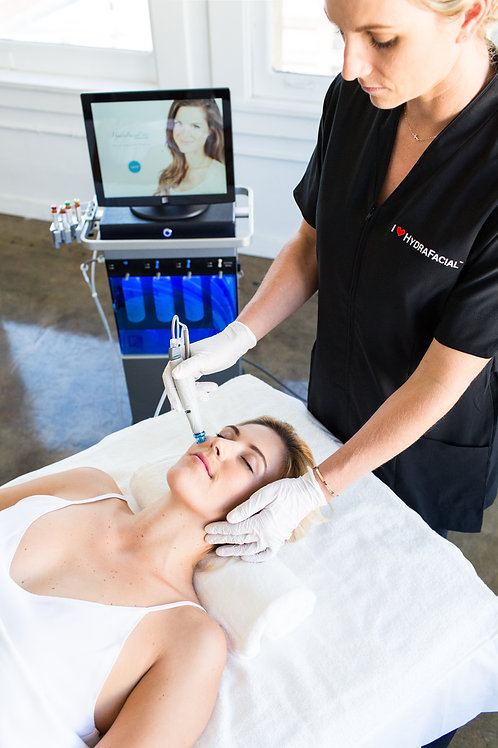 Nurse in black scrubs performing HydraFacial