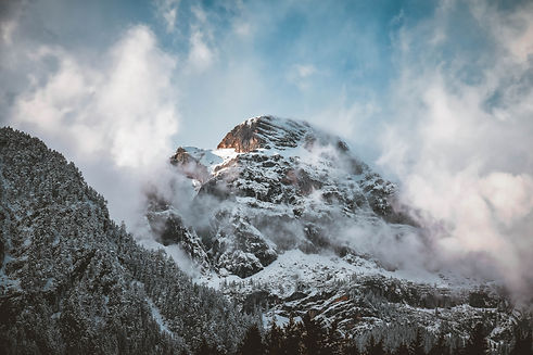 Canva - Snow-covered Mountain Peak.jpg