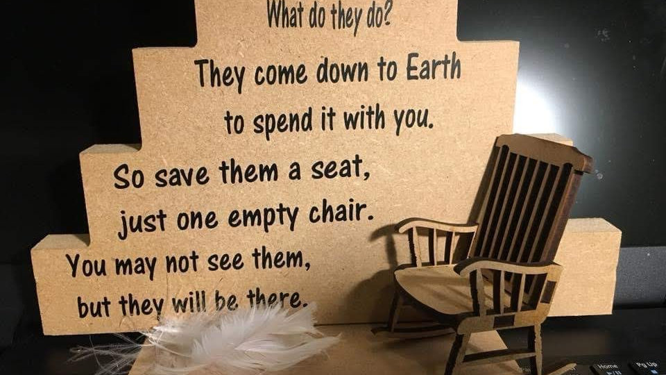 Empty Chair and Feather