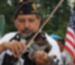 sk veteran pic with violin.jpg