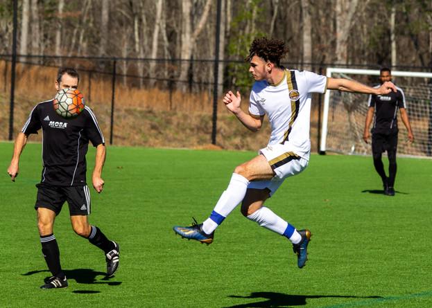 Soccer player kicking midair