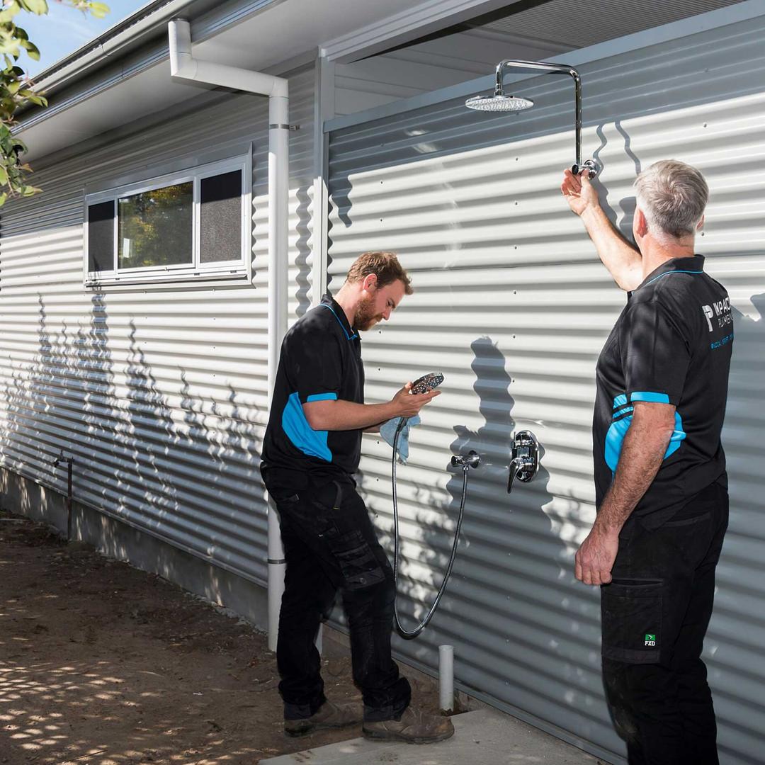 Tony-Sam-outdoor-shower-install.jpg
