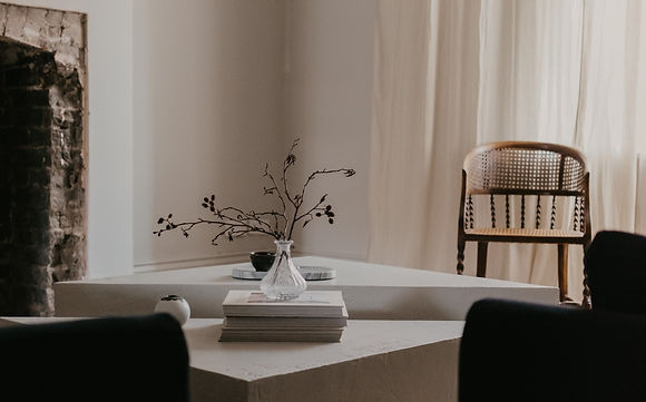 chic modern interior with coffee table books about destination wedding