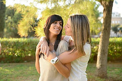 lesbian-couple-hugging-26833115.jpg