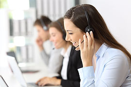Happy telemarketer working at call cente