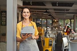 Portrait of happy woman standing at door