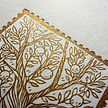detail of linoprint, gold ink on white, tree branches