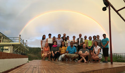 Our team in front of the rainbow on the dance floor