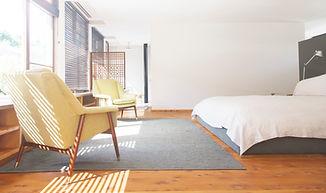 Light and organized minimalistic master bedroom