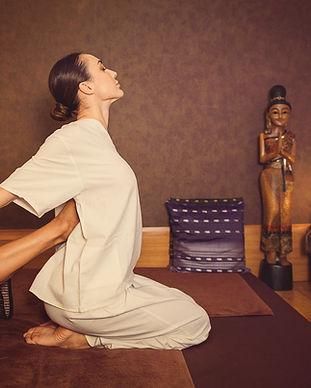 Serene girl enjoying thai massage.jpg
