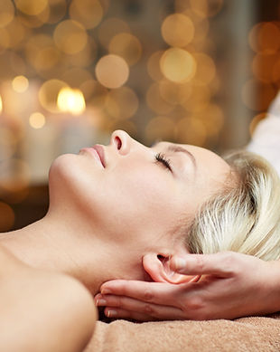 people, beauty, spa, healthy lifestyle and relaxation concept - close up of beautiful youn