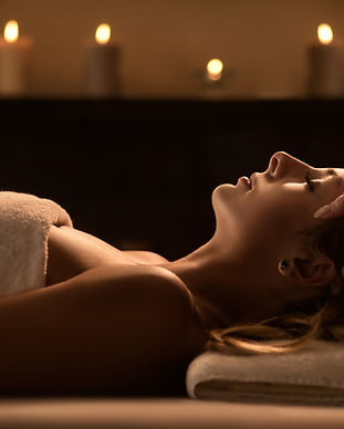 Young woman enjoys massage in a luxury spa resort.jpg