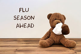 Flu_ teddy bear with a tissue because of