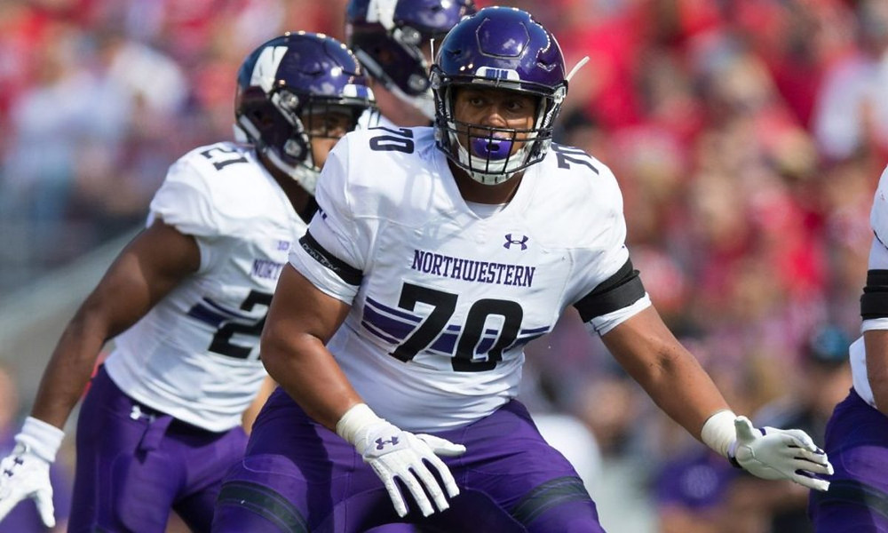 NFL Football, NCAA football, Rashawn Slater, Northwestern University, OT, Helmet, Uniform, Purple